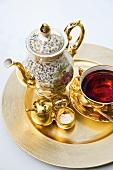 Gold tea set with wild berry tea