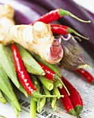 Vegetables and spices on Asian newspaper