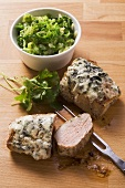 Pork fillet with melted Roquefort and savoy cabbage