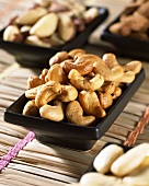 Toasted cashew nuts in dishes