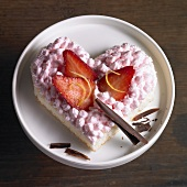 Heart-shaped sponge cake with strawberry cream