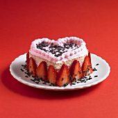 Heart-shaped sponge cake with strawberry cream
