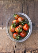 Tomatoes, variety 'Black Plum', in glass dish