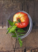 One tomato, variety 'Ochsenherz', in glass dish