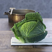 Savoy cabbage, cooking pot in background