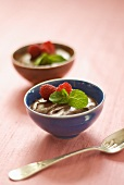 Two bowls of mousse au chocolat with raspberries