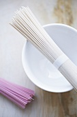 Pink and white somen noodles with a bowl