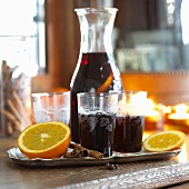 Mulled wine with oranges and cinnamon in glasses and carafe