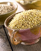 Buckwheat grains in terracotta pot