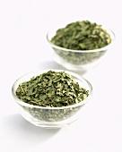 Dried tarragon (Artemisia dracunculus) in glass dishes