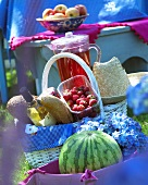 Strawberries, bread and wine in picnic basket