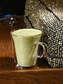 Cold cream of cress soup in glass cup