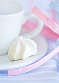 Cup and saucer with meringue