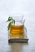 Two glasses of tarragon liqueur