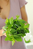 Woman holding a bunch of mint