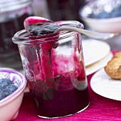Blueberry jam in jar with spoon