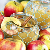 Apple compote with cinnamon stick in preserving jar