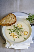 Cream of parsnip soup with parsnip crisps and cress