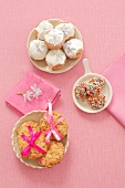 Oat biscuits, chocolate truffles with sprinkles, mini-cupcakes