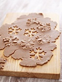 Snowflakes cut out of Lebkuchen (gingerbread) dough