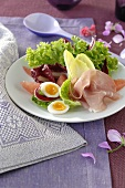 Salad leaves with ham and egg