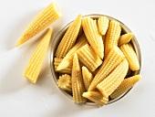 Baby corn in tin (overhead view)