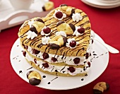 Puff pastry heart with cream and cherries
