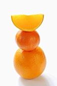 Orange, clementine and orange wedge, stacked