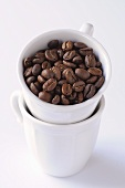 Coffee beans in stacked cups