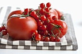 Various types of tomatoes on tea towel