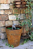Old flowerpot with fountain