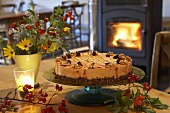 Rose hip cake on table in front of fire