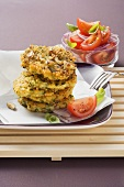 Millet cakes with tomato salad