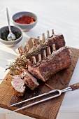 Barbecued racks of lamb with rosemary, salsa rossa and salsa verde