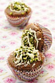 Cupcakes with chopped pistachios and white chocolate
