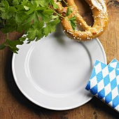 Empty plate, pretzel and napkin
