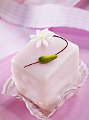 A petit four decorated with a flower