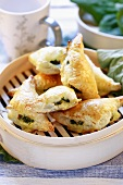 Spinach pasties in bamboo basket