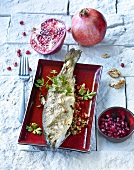 Trout with pomegranate and walnut stuffing