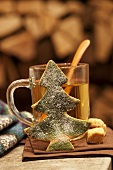 Hot punch, sugar cubes and Christmas biscuit