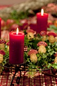 Advent wreath with mushroom-shaped biscuits