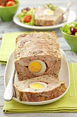 Meatloaf with egg, a slice cut