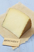 Piece of Manchego cheese on paper