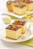 Cheesecake with chocolate icing and candied fruit