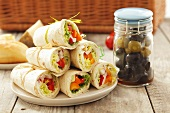Wraps and pickled olives for a picnic