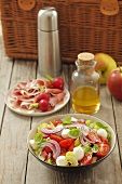 Tomato and mozzarella salad and ham with radishes for a picnic