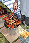 Barbecuing food on barbecue bucket