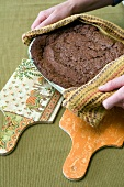 Chocolate cake on home-made chopping boards