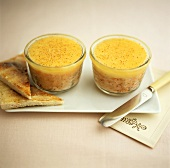 Duck rillette in glass dishes and toast triangles
