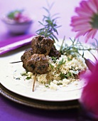 Mince skewered on rosemary with couscous